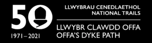 White text on a black background with banner logo for Offa's Dyke Path 50th anniversary. The figure zero has an acorn in the centre. Logo dathliad penblwydd 50fed Llwybr Clawdd Offa.